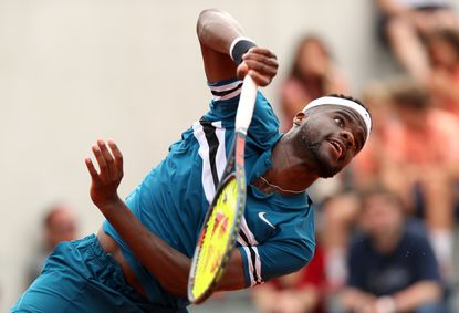 Frances Tiafoe serves duringa first-round match against Sam Querry during day two of the French Open at Roland Garros on May 28, 2018 in Paris.
