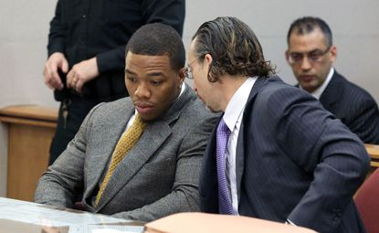 Baltimore Ravens player Ray Rice, left, confers with lawyer Michael Diamondstein in the Atlantic County court house in Mays Landing, Thursday May 1, 2014, for his arraignment.