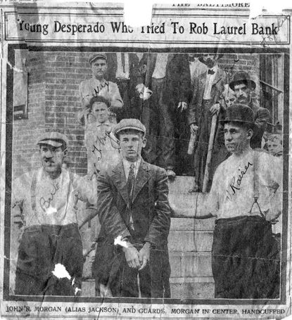 A photo in the Sept. 9, 1911 Baltimore Sun showed would-be robber John R. Morgan in custody in front of Citizen's National Bank on Main Street, as Constable Valentine Kaiser, right, leads him away.