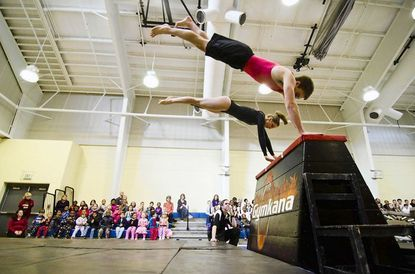 Joe Kreft performs with one of his teammates on the University of Maryland's Gymkana team during the Feb. 10 exhibition at St. Agnes School. Kreft, a Catonsville resident now a junior majoring in electrical engineering on the College Park campus, is a graduate of St. Agnes.