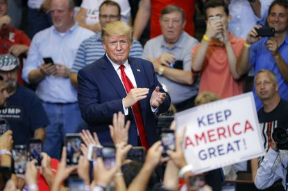 President Donald Trump arrives at a campaign rally at U.S. Bank Arena on Thursday, Aug. 1, 2019, in Cincinnati.