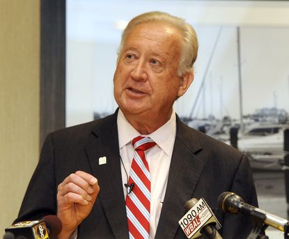 About a dozen people called for Anne Arundel County Council chairman Michael Peroutka's resignation at a meeting Monday.