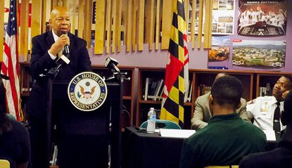 Rep. Elijah Cummings addresses students at a gathering in Forest Park High School's learning center Tuesday.