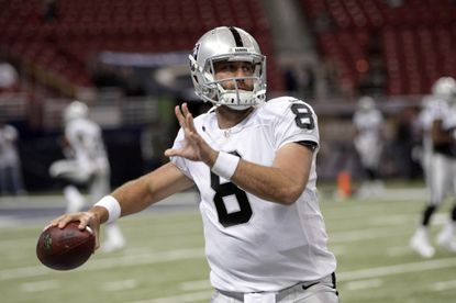 Oakland Raiders quarterback Matt Schaub warms up before the start of a game against the St. Louis Rams.