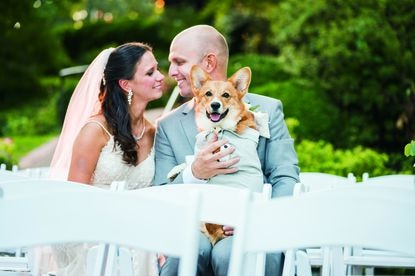 Katy and Brandon Sanders hold Rocket, their 9-month-old corgi.
