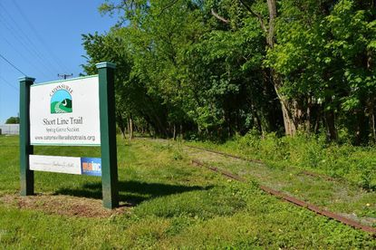 A 400-foot portion of the Short Line Trail is shown before it was developed into a trail in 2016.