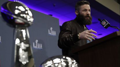 New England receiver Julian Edelman answers questions near the Lombardi Trophy and his Super Bowl MVP trophy during a news conference Feb. 4 in Atlanta.