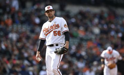Baltimore Orioles' Darren O'Day stands on the mound after giving up two solo home runs to the Detroit Tigers in the eighth inning of a baseball game, Sunday, May 15, 2016, in Baltimore.