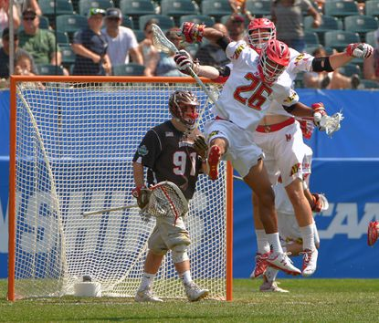 Maryland Terrapins midfielder Isaiah Davis-Allen (26) leaps with midfielder Henry West after scoring a goal on Brown Bears goalie Jack Kelly (91) during the 2016 NCAA men's lacrosse Division I championship semifinals.