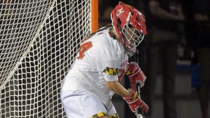 Maryland Terrapins goalkeeper Megan Taylor blocks a Northwestern Wildcats shot during the 2019 Women's Division I lacrosse semifinal game at Homewood Field.