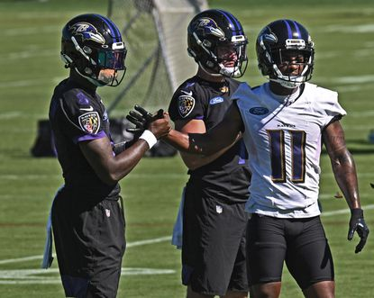 Baltimore Ravens quarterback Lamar Jackson, left, shakes hand with wide-receiver James Proche II, right, during Mandatory Team Minicamp at Under Armour Performance Center on June 16, 2021.