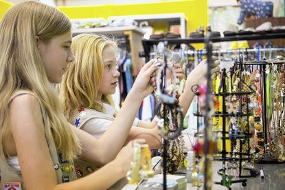 Ashleigh Jankowski, 13, left, and Angel Pfluger, 13, both of Catonsville, organize and look through jewelry for sale at the thrift shop that members of Girl Scout Troop 3131 built inside St. John's United Church of Christ on South Rolling Road.