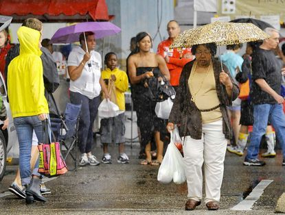 The crowds were lighter at the Baltimore Farmers Market under the JFX due to the Intermittent heavy downpours on Sunday. Morning showers, added to the heavy rain on Saturday, has led to flash floods in the region.