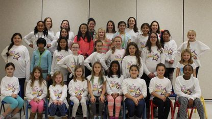 This is the Girls on the Run group from Dayton Oaks Elementary School with their coaches at the after-run celebration.