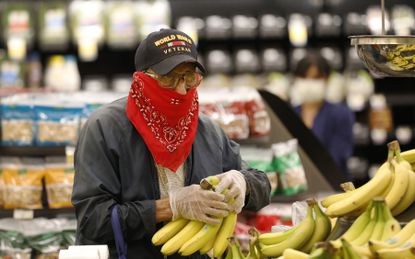 A 93-year-old World War II Veteran shops at a grocery store in Torrance, California. Torrance. Doors to the store opened at 6 a.m. for seniors and at-risk shoppers due to the Coronavirus and at 7 a.m. for other customers.