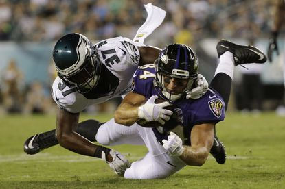 Ravens wide receiver Tom Nelson, right, is tackled by the Philadelphia Eagles' Jaylen Watkins during the second half of a preseason game in Philadelphia.