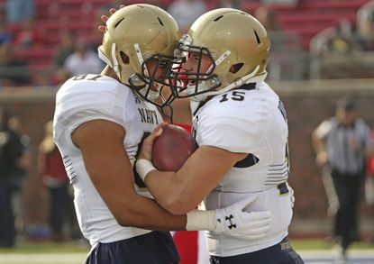 Navy wide receiver Brandon Colon, left, and quarterback Will Worth celebrate a touchdown during the first half of a game against SMU at Ford Stadium in Dallas on Saturday, Nov. 26, 2016.