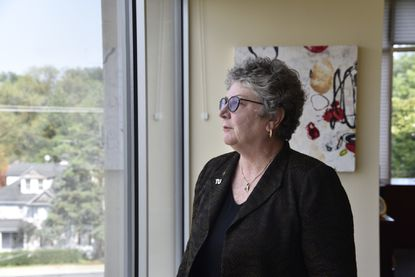Towson University President Kim Schatzel, shown last year in her office on the school campus, is taking a 10% cut in her current salary of $398,425.