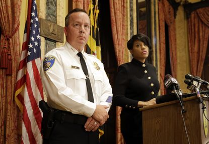 Interim Baltimore Police Department Commissioner Kevin Davis, left, and Mayor Stephanie Rawlings-Blake address reporters at a recent news conference. (AP Photo/Patrick Semansky)