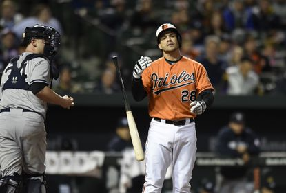 Orioles' Steve Pearce reacts after striking out against the New York Yankees in the second game of a doubleheader in Baltimore, Saturday, Oct. 3, 2015.