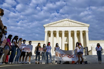 Members of the abortion rights group Reproaction demonstrate outside the U.S. Supreme Court in Washington, D.C. on Sept. 9, 2021. A man in Arkansas and another in Illinois on Monday, Sept. 20, 2021, filed what appeared to be the first legal actions under a strict new abortion law in Texas that is enforced by ordinary citizens, regardless of where they live. (Kenny Holston/The New York Times)