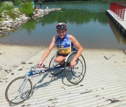 Daniel Romanchuk, 13, poses for a picture at Centennial Lake. Daniel will be competing in the Celebrating Heroes Triathlon.