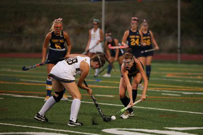 Catonsville High's Ava Waddell, left, battles for the ball during a 2019 field hockey game against Perry Hall. Waddell is one of two returning starters back for the shortened winter season.