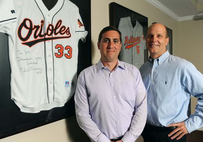Marriottsville, Md--11/13/14-- Left to right, Nick Durastanti, director of business development, and Joseph Geier, president and CEO, Winpoint Financial, stand next to framed player jerseys in the board room. Winpoint manages the finances of professional athletes.