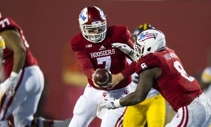 Indiana quarterback Nate Sudfeld (7) drops back to hand off to running back Jordan Howard (8) during the second half in Bloomington, Ind., Saturday, Nov. 7, 2015. Iowa won, 35-27.