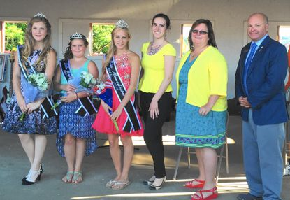 From left, Junior Miss Manchester Abigail Hoy, Little Miss Manchester Gracie Morris and Miss Manchester Julia Brocato stand alongside judges Colleen Frances, Sandy Mancha-Wright and Steve Wantz after their coronation during the Manchester fire company carnival June 29.