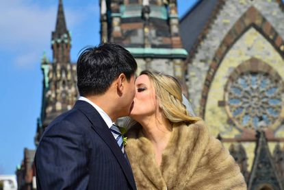 The couple poses for a kiss in Mount Vernon
