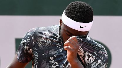 Frances Tiafoe of the US reacts as he plays against Serbia's Filip Krajinovic during their men's singles first round match on day two of The Roland Garros 2019 French Open tennis tournament in Paris on May 27, 2019.
