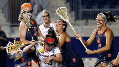 Maryland's Megan Whittle (McDonogh), center, gets squeezed by Syracuse's Haley McDonnell, left, and Mallory Vehar, right, during the second half of the women's lacrosse semifinals Friday, May 22, 2015, in Chester, Pa. Maryland won, 10-8.