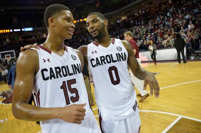 COLUMBIA, SC -- PJ Dozier, #15, and Sindarius Thornwell, #0, of the South Carolina Gamecocks leave the floor after their game against the Vanderbilt Commodores at Colonial Life Arena on January 9 in Columbia, S.C. South Carolina won 69-65.