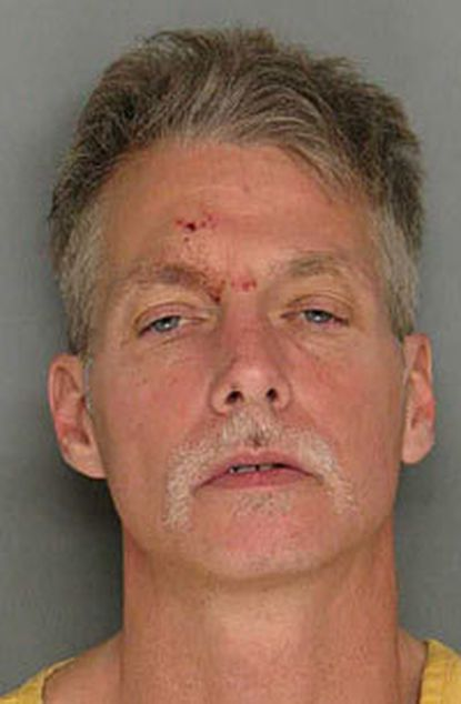Bradford Steven Holup, 49, of Baltimore was arrested and charged with attempted murder, assault and burglary in connection with the robbery of a Towson home.