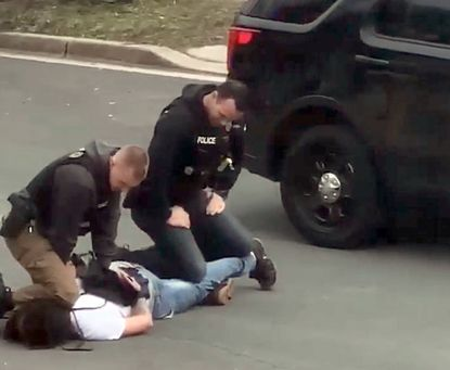 Daniel Jarrells, pictured on the ground, sued Anne Arundel County, its police department and three detectives for a February 2019 encounter in Gambrills. The lawsuit claims the detectives pulled him over for no reason and eventually threw him to the ground and knelt on his neck.