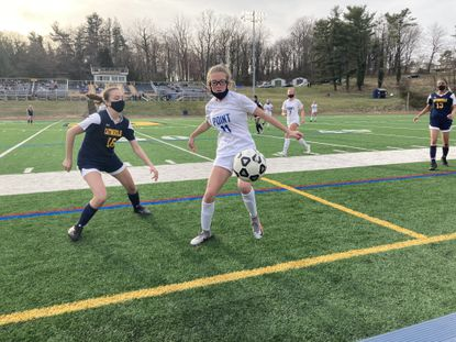 Catonsville's Isabella Powell, left, defends Sparrows Point's Bailey Arnett in the Comets' 2-0 loss to the Pointers.