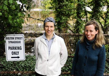 Aleeza Oshry, left, and Amy Bonitz stand in the back parking lot of the Bolton Street Synagogue in March 2012, near the Stony Run. They were working on transforming the parking lot of the synagogue so that joggers would have a path to run through. Last week, the state awarded Baltimore City's Department of Recreation and Parks a $600,000 grant to improve the Stony Run walking path and fill in gaps in the path, including at the synagogue.