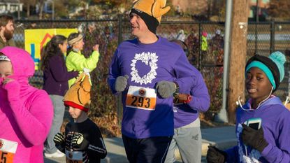 Peter DeMik of Laurel with 8-year old son Nathan DeMik; Sydney Aldred of Laurel, 13, is on the right, at the 2017 Turkey Trot to benefit Laurel Advocacy and Referral Services. This year's trot takes place on Nov. 22 at 8 a.m.