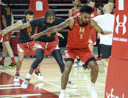 Maryland men's basketball players workout at the team's media day in College Park, Md.