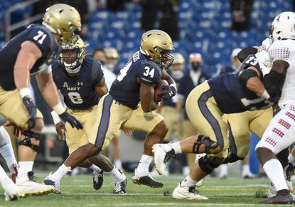 Navy fullback Jamale Carothers, running against Temple in October, has been dismissed from the Naval Academy and has entered the NCAA transfer portal.