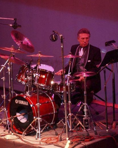 Longtime Elvis Presley drummer D.J. Fontana performs at the 50th anniversary celebration concert of Elvis Presley's first performance at the Louisiana Hayride in Sherveport, La., in 2004.