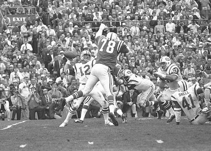 Super Bowl III was a day Baltimore Colts fans would just as soon forget, as Joe Namath (12) and the Jets took down the highly favored Colts, 16-7. Above, Bubba Smith (78) tries to block a pass by Namath.