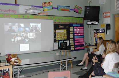 Eighth grade students at St. Joan of Arc School participate in Conclave Web Chat recently with the archbishop of Baltimore.