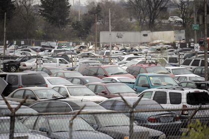 Cars sit in the elements at Baltimore City's Towing Division on Pulaski Highway.