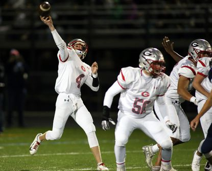 Glenelg quarterback Mason Davis (4), seen throwing a touchdown against River Hill, played a key role in helping the Gladiators win their second straight Howard County championship this season.
