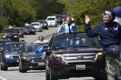 South River High School Class of 2020 seniors make their way down a road during a community-organized parade, Saturday, April 25, 2020. Many of the South River High School families found ways to celebrate their seniors given that prom, graduation and other traditional senior activities were canceled. (AP Photo/Susan Walsh)