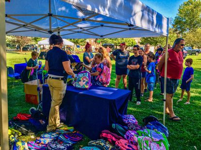 Aberdeen Police gave out backpacks and school supplies to kids in need at Festival Park on Aug. 29, as part of the PACK (Police Assisting Community Kids) campaign. The police department is continuing to collect donations through the end of September.