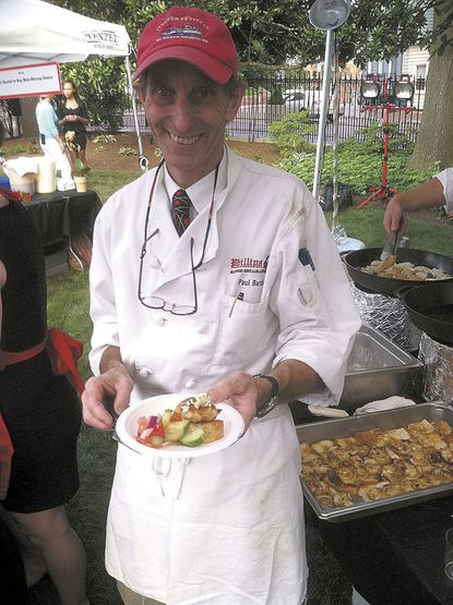 Chef Paul Bartlett of Phillips Crab Deck dishes up a soft shell crab delicacy at the governor's Buy Local Cookout.