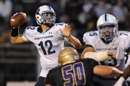 Pallotti sophomore quarterback Mason Clark, shown here in an early-season win over Loch Raven, threw two touchdown passes Saturday to lead the Panthers to 43-14 victory over Annapolis Area Christan School in the MIAA C Conference championship game
